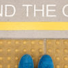 "The sign "" Mind the gap "" painted on train station's platform edge"